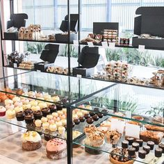 Cakes in rows at Albion Provisions. Our second store is located at 97 Sandgate Road for those of you that have been asking! It's down the laneway & next to @magnoliainteriors , parking a plenty as well. 😊