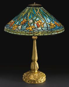 "Tiffany Studios, New York, Favrile Leaded Glass and Gilt Bronze ""Daffodil"" Lamp. in 2019 . Stained Glass Lamp Shades, Tiffany Stained Glass, Tiffany Glass, Stained Glass Art, Stained Glass Windows, Louis Comfort Tiffany, Antique Lamps, Vintage Lamps, Chandelier Design"