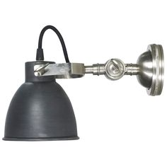 Add wall-to-wall style with the Lene Bjerre Mary Wall Light. The light offers a contemporary take on a classic design of the wall light. It features a classic lamp head with an industrial colour finish. This is held in place with a clamp arm support which is attached to a rounded wall mounted base. The arm and base of the lamp have an aluminium finish, offering a striking contrast and exuding an industrial aura. The wall lamp requires 1 x E14 bulb (not included) while the direction of light…