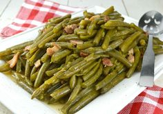 Southern Style Green Beans-  Cooked low and slow to create a tender green bean that is beyond delicious. While you may be tempted to skip the bacon, don't!! If you have only bacon drippings, that'll work too simply by adding a bit of drippings to the water/broth.