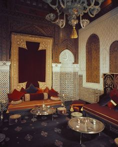 In the formal salon, the sofa is covered with an Indian fabric and hand- embroidered jewelled cushions which are stitched with real gold thread. Japanese Screen, Mirror House, French Windows, Indian Fabric, Moroccan Design, Blue Rooms, Pink Walls, Modern Carpet, Petite Fille
