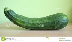 One courgette with green background