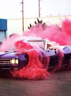Joanne era Lady Gaga in vintage car with pink smoke