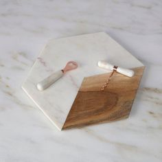 This uniquely shaped marble and wood cutting board can also be used as a serving…