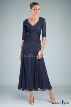 Sophisticated and elegant portrays this simple A-line mother of the bride dress featuring enticing V-neckline and half sleeves accentuating with gorgeous ruching. Nice pleats run over the formfitting bodice while the sleek skirt drapes naturally down to the tea-length hemline. Finished with zipper back closure.