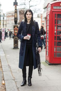Katlin Aas in a long trench in London.