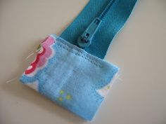 Flossie Teacakes: Lined, zippered pouch / make up bag tutorial - Love this because of the fabric covered zipper ends.  Great idea for other craft/zippered projects.