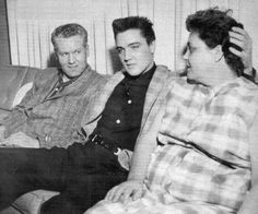 Elvis Presley with his parents Gladys & Vernon in the days before he has to leave for Army basic training. Note his pre-army haircut....