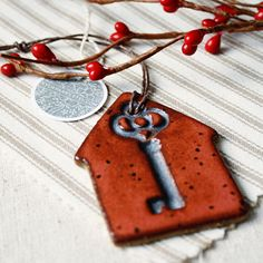 Handmade Christmas ornament- rustic red skeleton key. $12.00, via Etsy.