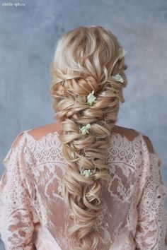 long curly braided hairstyle with flowers