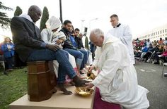Pope Francis washed and kissed the feet of twelve Muslim, Christian and Hindu refugees Thursday during an Easter Week service at an asylum center outside of Rome.