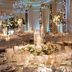 Love the delicate white goblets next to #rose #centerpieces for this blue #uplighting reception. Photo via #bridalguide