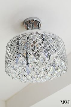 This chandelier is under $150 and is such a statement piece for foyers, kitchens and other small rooms/areas.