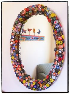 Decorate a mirror's frame From: If You Keep Your Bottle Caps, You Can Do These 20 Epic Things With Them x-Viral.com