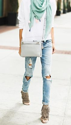 Boho chic done in a minimal way with ripped jeans, fringe heels, and a structured crossbody bag.