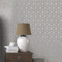This contemporary Rochester Geometric Wallpaper features a geometric cube pattern with contrasting finishes and textures for added depth and interest. The design is made up of a shimmering metallic silver set upon a soft grey background with a weathered texture which gives a softness that would not be achievable using solid colours. The clever geometric pattern changes before your eyes depending on the viewing angle and lighting in your room and could be used to create an interesting feature…
