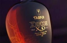 """We value our Ukrainian customers and are proud that the House of Vintage Cognacs Tavria has been entrusting us for many years to decorate glass packaging for elite cognacs of the Extra Old category """"Tavria XO""""! Glass Packaging, Brand Architecture, Glass Engraving, Brand Advertising, Article Design, Packaging Design Inspiration, The Collector, Glass Bottles, Whiskey Bottle"""