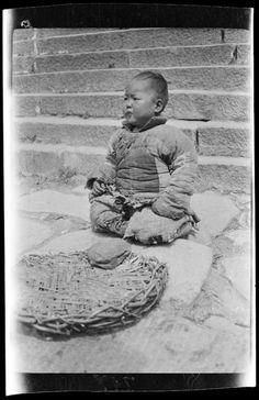 Beggar Boy. China, Tai Mountains, 1917-1919. (Photo by Sidney David Gamble)