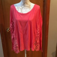 NWOT.  Free People lightweight sweater. Medium NWOT Free People. Gorgeous coral color. Oversized fit. Sides are entirely open work crochet. Very lightweight. Maybe as a coverup for spring break? Free People Sweaters