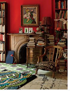 Red wall and Matisse are great in a book nook