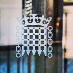 Houses of Parliament Logo on some glass doors at the entrance to the estate in London.. #westminsterhall #logo #glass #reflection #london #westminster #westminsterbridge #thames #river #capital #arch #architecture #historic #history #parliament #housesofparliament #government #royalty #landmark #bluesky #clouds #touristattraction #tourist #england #travel