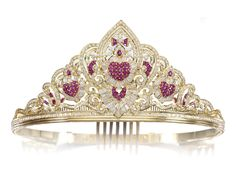 RUBY, SYNTHETIC RUBY AND DIAMOND TIARA.  The front of festoon and heart design set with brilliant-, step-cut and marquise-shaped diamonds, embellished with calibré-, French-cut, baguette and pear-shaped rubies and synthetic rubies, inner circumference approximately 150mm, with four optional size fittings to reverse, fitted case.