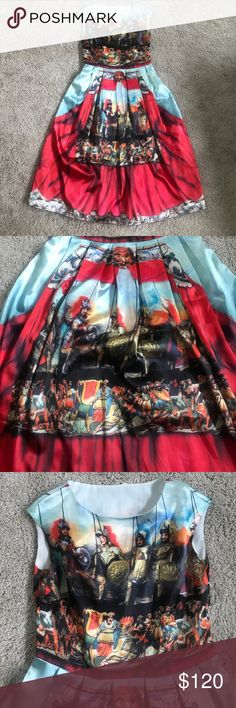 D&G style Soldier dress Dolce and gabbana style soldier dress. This dress is not made by D&G, nor is it listed as such. It is tagged as a small. I am a 4 and it was perfect. There are a couple lose threads but nothing majorly wrong with this dress. Hidden side zip. Dresses