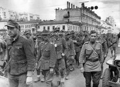 Kiev, Ukraine, Aug 16, 1944: Thousands of German POWs are paraded through city streets as the locals hurl curse and abuse at them. The official report about the Kiev situation to Stalin claimed the Red Army had taken 36,918 POWs including 549 officers.