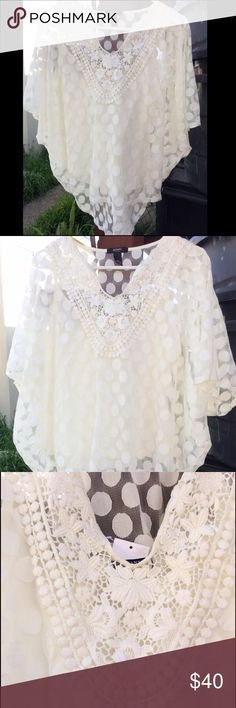 NEW Alfani White Sheer Blouse/Tunic w/ Embroidery Gorgeous blouse!! It is a white sheer blouse that comes with an under piece (white cami). The detail on this blouse is absolutely stunning & one of a kind! It has an embroidered intricate design in the front near the breast area with a circle embroidered design all throughout. This blouse is tailored in a v-shaped form at the end. This blouse is NEW with tags! Also, price is negotiable! Alfani Tops Blouses