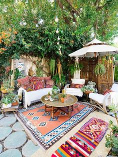 layered rugs in a boho patio