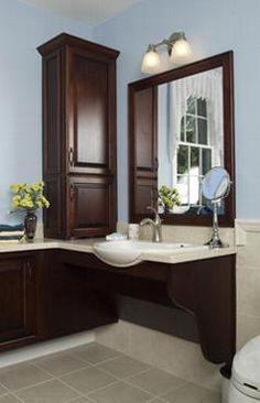 Great place to roll under the sink and a low mirror is usable by anyone that is short, seated, or standing.