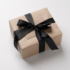 kraft box with thick black ribbon