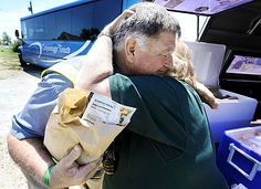 Jim Groff, a Lions Club member from Christiana, Pa., hugs Nancy Gauthier, a Lions Club member from Parksburg, Pa., on Friday after she delivered his lunch. Groff has made three trips to Joplin to help in the storm recovery.