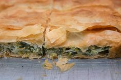 This version of the Greek spinach pie called spanakopita layers everything on a single baking sheet rather than requiring the shaping and folding of individual pies.