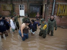 Soldiers help a woman leave her flooded house to take her to a shelter in Zoatlan. Hurricane Patricia made landfall Friday on a sparsely populated stretch of Mexico's Pacific coast as a Category 5 storm, avoiding direct hits on the resort city of Puerto Vallarta and the major port city of Manzanillo as it weakened to tropical storm force while dumping torrential rains that authorities warned could cause deadly floods and mudslides.  Eduardo Verdugo, AP