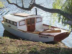 Small Houseboats | Below looks like a modified fishing boat that has been converted to a ...