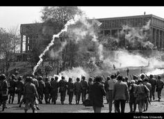 The Ohio National Guard fire tear gas to disperse the crowd of students gathered on the commons on May 4, 1970. Kent State