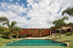 Dreamy, especially that swimming pool.... | jacobson arquitetura's MDA house is wrapped in warm teak skin—designboom