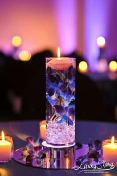 Floating candle centerpiece at wedding reception