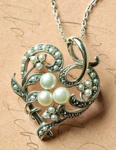 HOPESTILL HEART NECKLACE - Destined to endure as a cherished heirloom generations beyond, a heart-shaped delicacy is hand crafted of .925 Sterling Silver, cultured fresh water seed pearls and marcasites.
