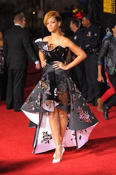 In a lazer-cut, high-low hemline Marchesa gown at the American Music Awards in 2009. - MarieClaire.com