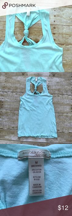 Ambiance Mint Key Hole Knot Tank Mint color, the photos show more blue but the tank is a true mint green. Worn a few times. EUC. No rips/holes/stains. Coming from a pet friendly home of an adorable Pomsky named Lulu :) Ambiance Apparel Tops Tank Tops