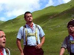 Bim Wäli uf de Alp (s'Häwee Zäuerli)  Beautiful brass adorned suspenders worn by these men singing a hauntingly melancholy beautiful song in the stunning Swiss landscape.  This type of song is called a Zäuerli.