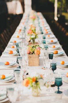 A beautiful table setting with a colorful use of tangerines.