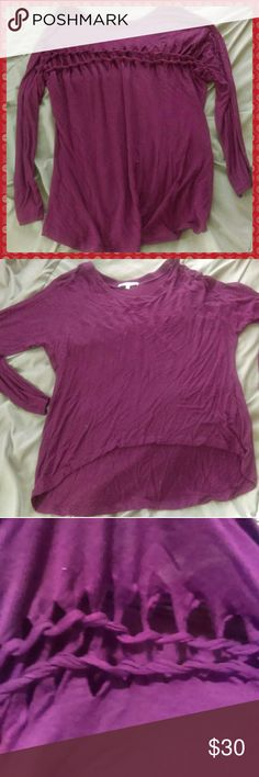 Purple high low shirt First picture is of the back. Super cute top. Naked Zebra Tops Blouses