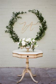 Greenery wedding decor and gold initials