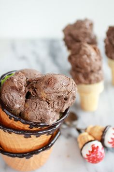 Chocolate Peanut Butter Swirl Fudge Brownie Ice Cream ~ Basically this is the ultimate ice cream. It is a milk chocolate ice cream base, with the fudgiest brownie chunks and a peanut butter swirl. It is what every warm spring, hot summer or cold snowy day needs. (make Paleo)