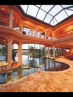 Indoor pool with waterfall to the outdoor pool