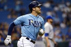 Tampa Bay Rays' Evan Longoria watches the flight of the ball after hitting a double off Toronto Blue Jays pitcher Brandon Lyon, right, during the eighth inning of a baseball game in St. Petersburg, Fla., Sunday, Sept. 23, 2012.