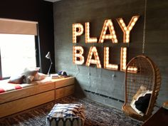 Great idea for Griff's room - on his black accent wall.  Will need to DIY the letters from paper mache ones with some paint and rub n buff